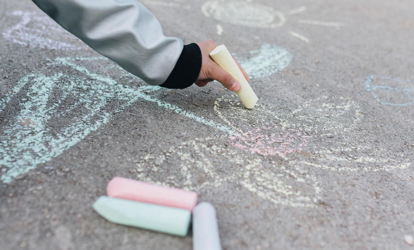 girl-drawing-with-chalk-road.jpg