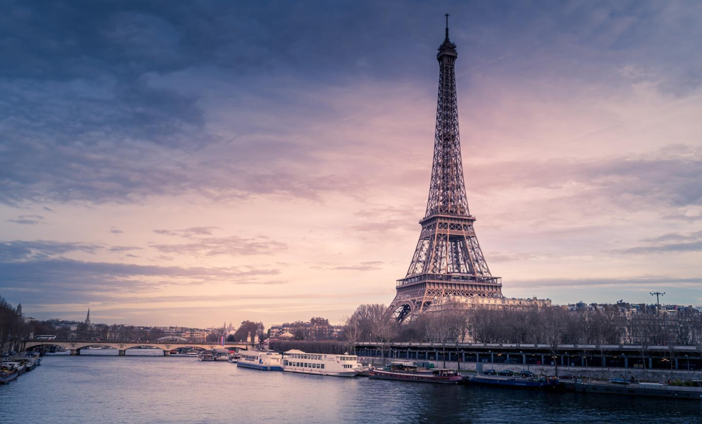 beautiful-wide-shot-eiffel-tower-paris-surrounded-by-water-with-ships-colorful-sky.jpg